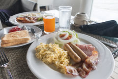 Large hot breakfast with scrambled eggs,  bacon Stock Photography