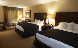 Large hotel room. Hotel room with a pair of king sized beds Royalty Free Stock Image