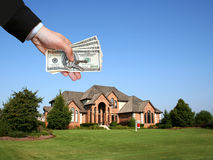 Large house. Hand and honey Royalty Free Stock Photography