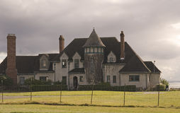 Large House on Cloudy Coast Royalty Free Stock Images