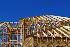 Large house frame. Frame of a large new house in a housing development in southwestern United States Stock Photos
