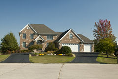 Large house with three car garage. House home real estate for sale subdivision residential Royalty Free Stock Image