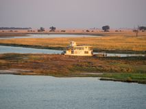 Large houseboat laying on Namibian side of bank of Chobe River in Chobe National Park, Botswana, Southern Africa Stock Photo