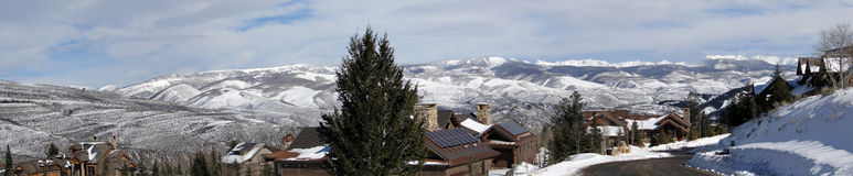 Large houses in winter mountains Stock Photos