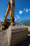 Large hydraulic backhoe in mountains royalty free stock photography