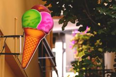 Large ice-cream signboard on wall Royalty Free Stock Images