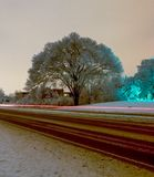 After a large ice storm a tree is covered in a beautiful layer of ice at night. Ice storm coats a large tree with a thick layer of ice along a rural road in Ann Stock Images