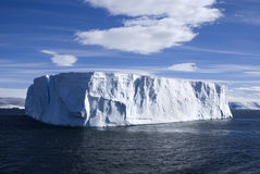 Large Iceberg. Large tabular iceberg with clear blue sky taken at Antarctica