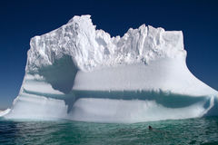 Large iceberg in the blue waters of Antarctic Stock Photography