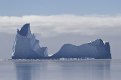 Large iceberg with a single vertex in the waters of the Southern Stock Photos