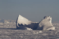 Large iceberg stuck in the Strait clogged with ice in the Antarc Royalty Free Stock Photography