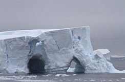Large iceberg in two caves in Antarctic Stock Photography