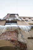 Large icicles hang on the facade. Of old living house. Winter in Saint-Petersburg, Russia royalty free stock image