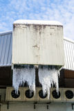 Large icicles hanging from industrial drains Royalty Free Stock Image