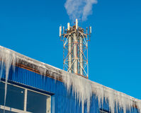 Large icicles hanging from the roof Stock Images