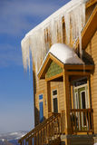 Large icicles on Townhouses after heavy snowstorm Royalty Free Stock Image