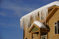 Large icicles on Townhouses after heavy snowstorm Stock Photos