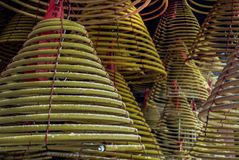Chinese traditional joss stick coils hanging on roof royalty free stock images
