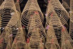 Large incense coils burning hanging from the ceiling of a Vietnamese Buddhist temple royalty free stock photos