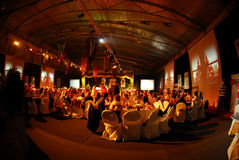 Large indoor party. Large party banquet inside through fisheye lens stock photo