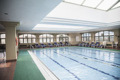 Large, indoor swimming pool with skylight. Royalty Free Stock Photo