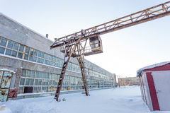 Large industrial building in abandoned factory area with rusty lift Stock Images