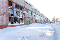 Large industrial building abandoned of factory with broken windows Royalty Free Stock Photography