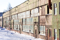 Large industrial building abandoned of factory with broken windows Stock Photos