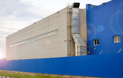 Large industrial building of blue color.  royalty free stock images