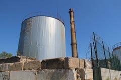 Industrial buildings three. Large industrial buildings against the sky stock photo