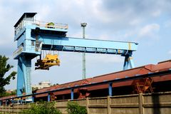 Large industrial crane for cargo containers Royalty Free Stock Photo