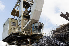 Large industrial crane and a heap of metal junk Stock Photo