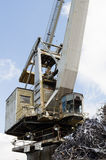 Large industrial crane and a heap of metal junk Royalty Free Stock Photo