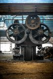 Large industrial hall with cogs. Of a machine Royalty Free Stock Images