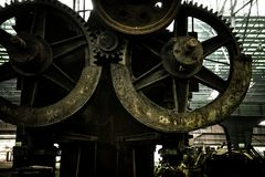 Large industrial hall with cogs Royalty Free Stock Photography