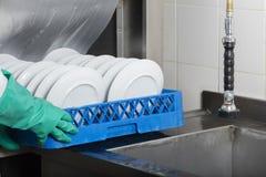 Large industrial kitchen dishwasher Stock Photography