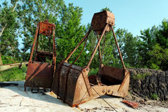 Large industrial machine on the shore Stock Photos