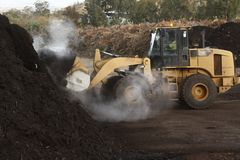 large industrial machinery being used at a garbage dump stock photo