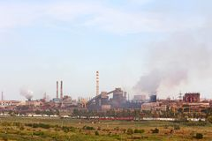 Large industrial plant with smoking factory chimneys on blue sky. Background. Environmental pollution concept royalty free stock images