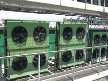 Large industrial power fans on the roof of the building. Hot air cooling. Large industrial power fans, compressor on the roof of the building. Hot air cooling Stock Photos