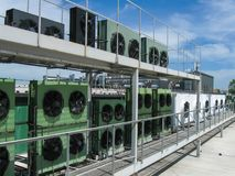 Large industrial power fans on the roof of the building. Hot air cooling. Large industrial power fans, compressor on the roof of the building. Hot air cooling Royalty Free Stock Photo