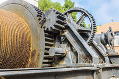 Large industrial pulley system with sprockets Stock Image