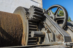 Large industrial pulley system with sprockets Stock Photos