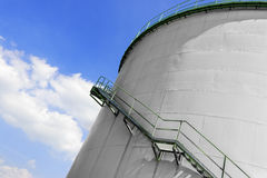 Large industrial silo with blue sky Stock Photos