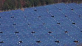Large industrial solar panel array zoom out. Industrial solar panel array zooming out from close up to full view stock footage