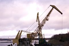Large industrial tower car floating crane tower stock photos