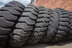 Large Industrial Tyres. Large industrial used tires in yard for resale royalty free stock photos