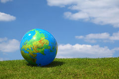 Large inflatable globe lies on grass Royalty Free Stock Photography