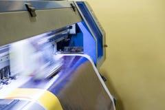 Large inkjet printer head working on vinyl banner. Large inkjet printer head working on blue vinyl banner Stock Photos