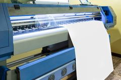 Large inkjet printer head working on white blank vinyl. Banner Royalty Free Stock Images